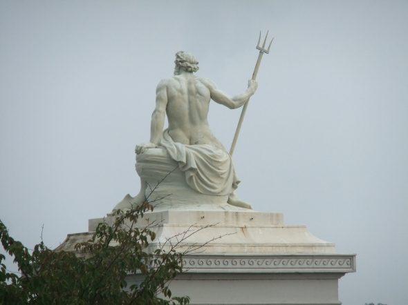 A Statue Of The Greek God Of The Sea, Poseidon at the harbor in Copenhagen.