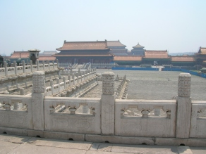 The whole complex had shiny, orange-roofed buildings and many big, open courtyards.