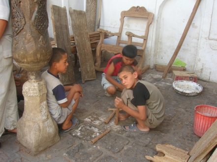 Young lads wood carving - Khiva
