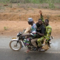 An entire family riding, Benin