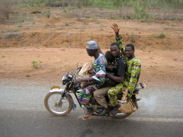 An entire family riding, Benin