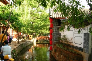 """""""Twinkling canals alongside brick pathways wound their way around homes with thatched roofs."""""""