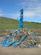Our very first ovoo was a rock cairn with threads of silky blue scarves tethered to a stick protruding upwards from the centre.