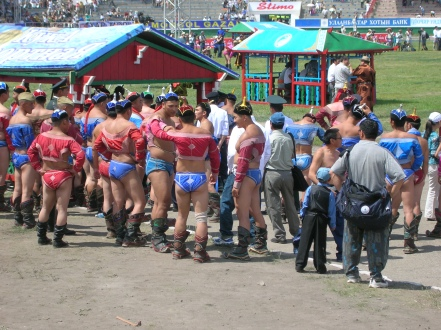 "The wrestlers wore Speedo-like blue ""underwear"" and tiny red jackets, which essentially were just sleeves that left their chests fully exposed."