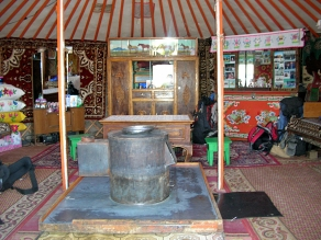 ...with a simple fire stove in the centre, a tiny sink, a table surrounded by four small stools, and a small shrine for worship on one of two dressers. I consciously remembered to honour their custom of not turning my back to the sacred shrine except when exiting the ger. Despite the fact that we had essentially taken over their home for the night and were both unexpected and unannounced, we couldn't have been more warmly welcomed.