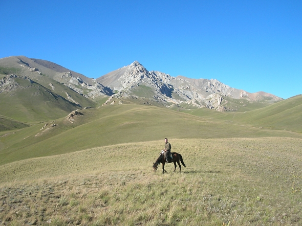 Horse country Song Kol, Kyrgystan. Backpacks and Bra Straps