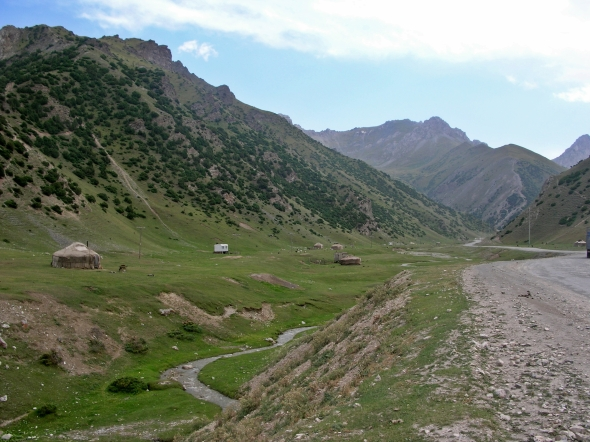 From Osh, we planned to re-enter China at a remote western border crossing – the lesser used of the two crossings into China from Kyrgyzstan. The scenery along the way featured numerous high passes and stupendous views of Tajikistan's Pamir mountain range.