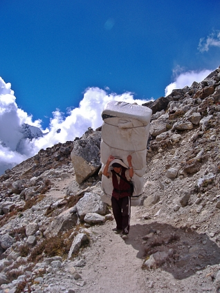 Sherpa in Himalayas, Nepal. Backpacks and Bra Straps