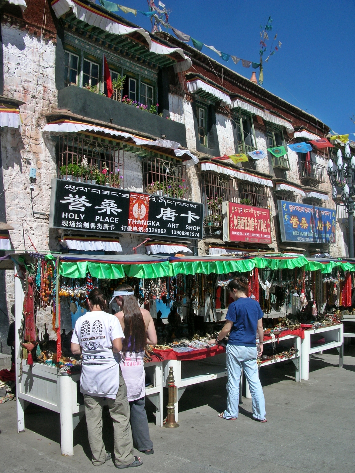 street shopping in Tibet. Backpacks and Bra Straps