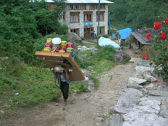 Sherpa carrying heavy load, Himalayas, Nepal. Backpacks and Bra Straps