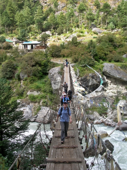 suspension bridges, Himalayas, Nepal. Backpacks and Bra Straps
