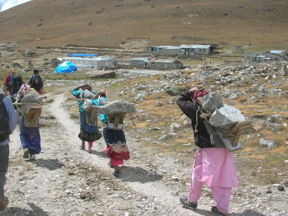 Ladies carrying rocks in Himalayas, Nepal. Backpacks and Bra Straps