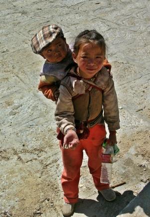 Begger kids in Tibet. Bacipacks and Bra Straps