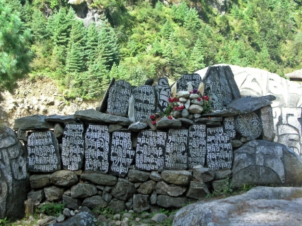 Prayer stones, Himalayas, Nepal. Backpacks and Bra Straps