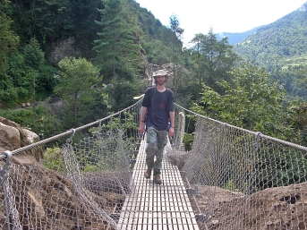 suspension bridges. Himalayas, Nepal. Backpacks and Bra Straps