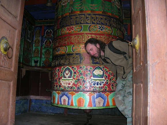 Prayer wheel in Himalayas, Nepal. Backpacks and Bra Straps