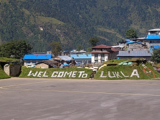 Lukla Airport, Nepal. Backpacks and Bra Straps
