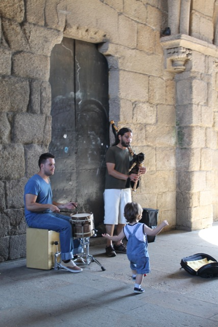 Street performers and young fan in Santiago de Compostela, Spain
